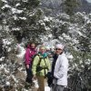 hikers along a snowy White rock loop trail